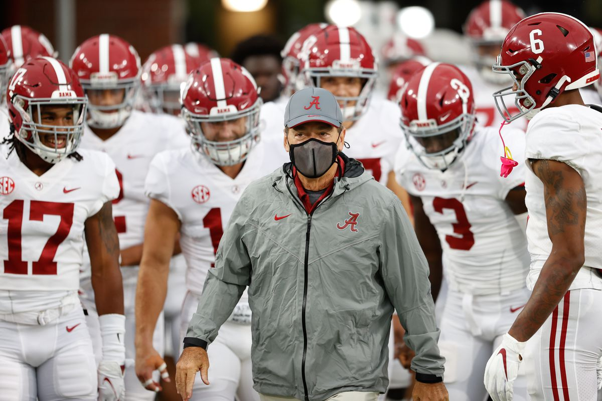Head coach Nick Saban of the Alabama Crimson Tide leads his team onto the field prior to the game against the Ole Miss Rebels at Vaught Hemingway Stadium on October 10, 2020 in Oxford, Mississippi.