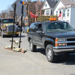 1:37 p.m. Escort vehicle for the concrete forms, parked in front of Taco Bell -