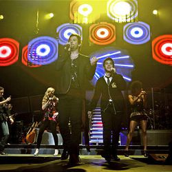 David Cook, left, and David Archuleta perform during the American Idols Live concert at the E Center in West Valley on Monday night.
