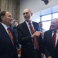 Gov. Gary Herbert, left, President Henry B. Eyring, first counselor in the First Presidency of the Church of Jesus Christ of Latter-day Saints, center, and Elder Robert K. Dellenbach share a laugh during a dedication ceremony for the Thomas S. Monson Lodge at the Hinckley Scout Ranch in the Uinta Mountains on Wednesday, Oct. 5, 2016.