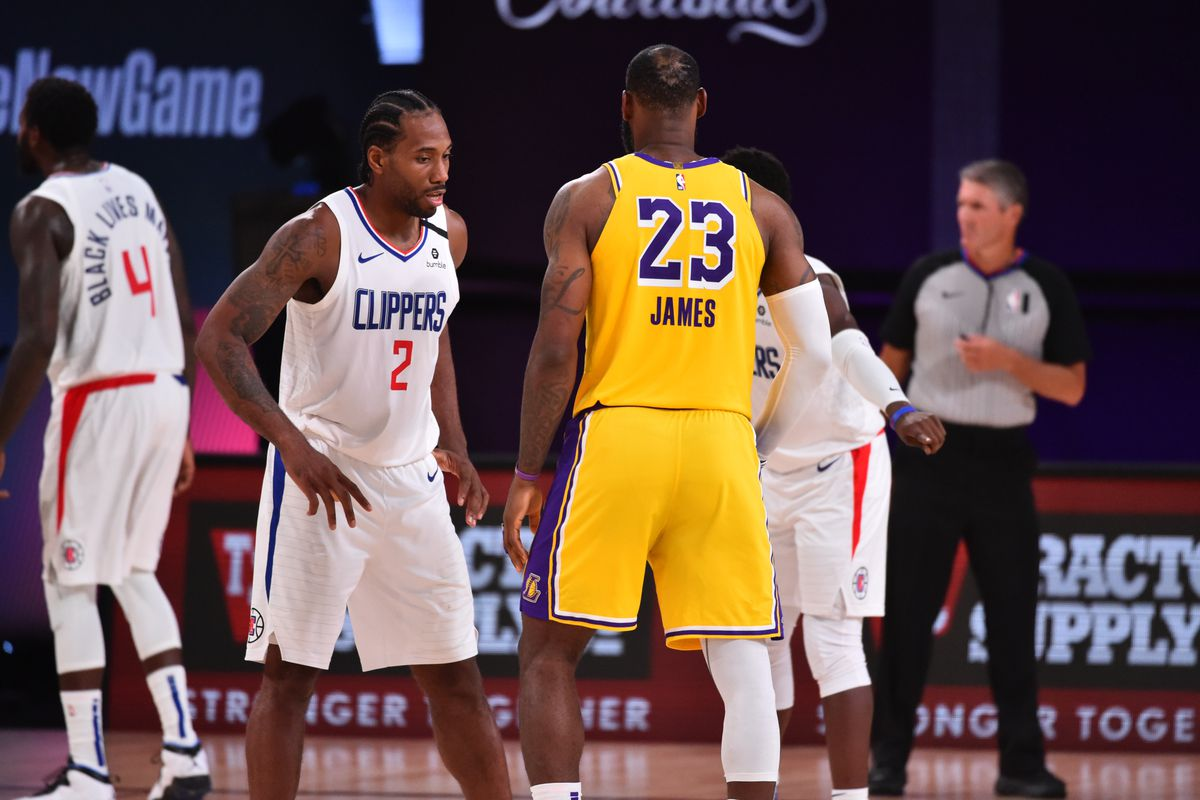 Kawhi Leonard of the LA Clippers plays defense against LeBron James of the Los Angeles Lakers on July 30, 2020 at The Arena at ESPN Wide World Of Sports Complex in Orlando, Florida.