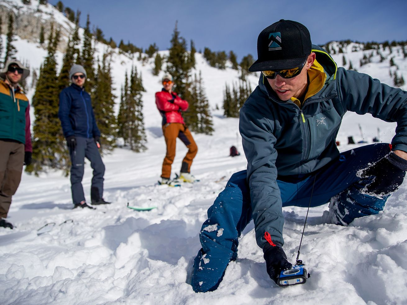 Utah Mountain Adventures Guide Joseph Hobby, right, demonstrates the basics of using an avalanche transceiver to search for a buried avalanche victim during a level 1 avalanche course in the Grizzly Gulch area of Little Cottonwood Canyon, near Alta, on Saturday, Dec. 21, 2019.
