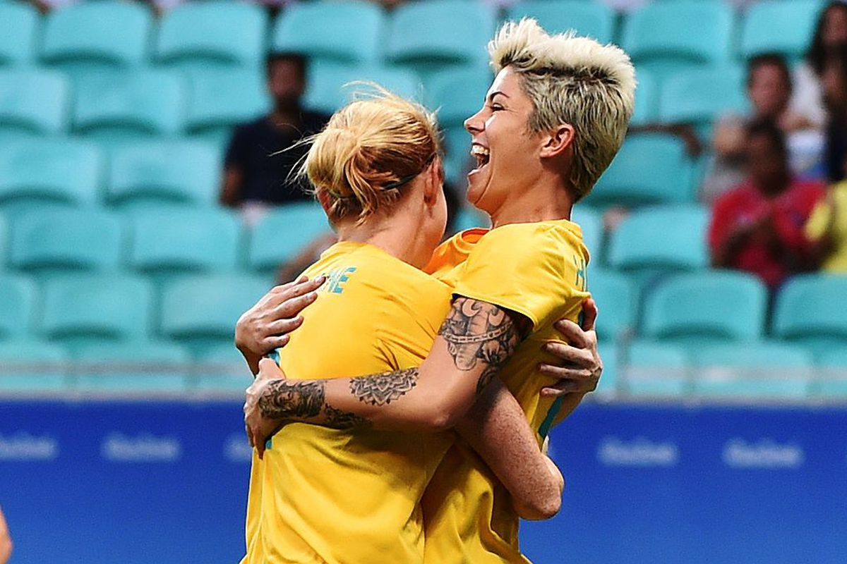 Michelle Heyman, right, celebrates scoring a goal in the Olympics group play.