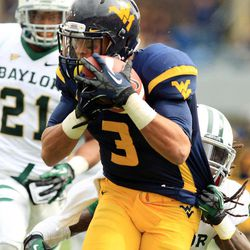 West Virginia receiver Stedman Bailey (3) catches a pass and is tackled by Baylor's K.J. Morton (8) as Baylor's Josh Wilson (21) looks on during their NCAA college football game in Morgantown, W.Va., Saturday, Sept. 29, 2012. West Virginia beat Baylor 70-63.