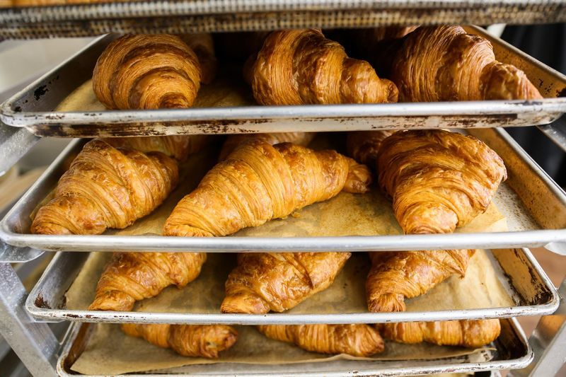 Croissants on a baking rack at Bakery Nouveau.