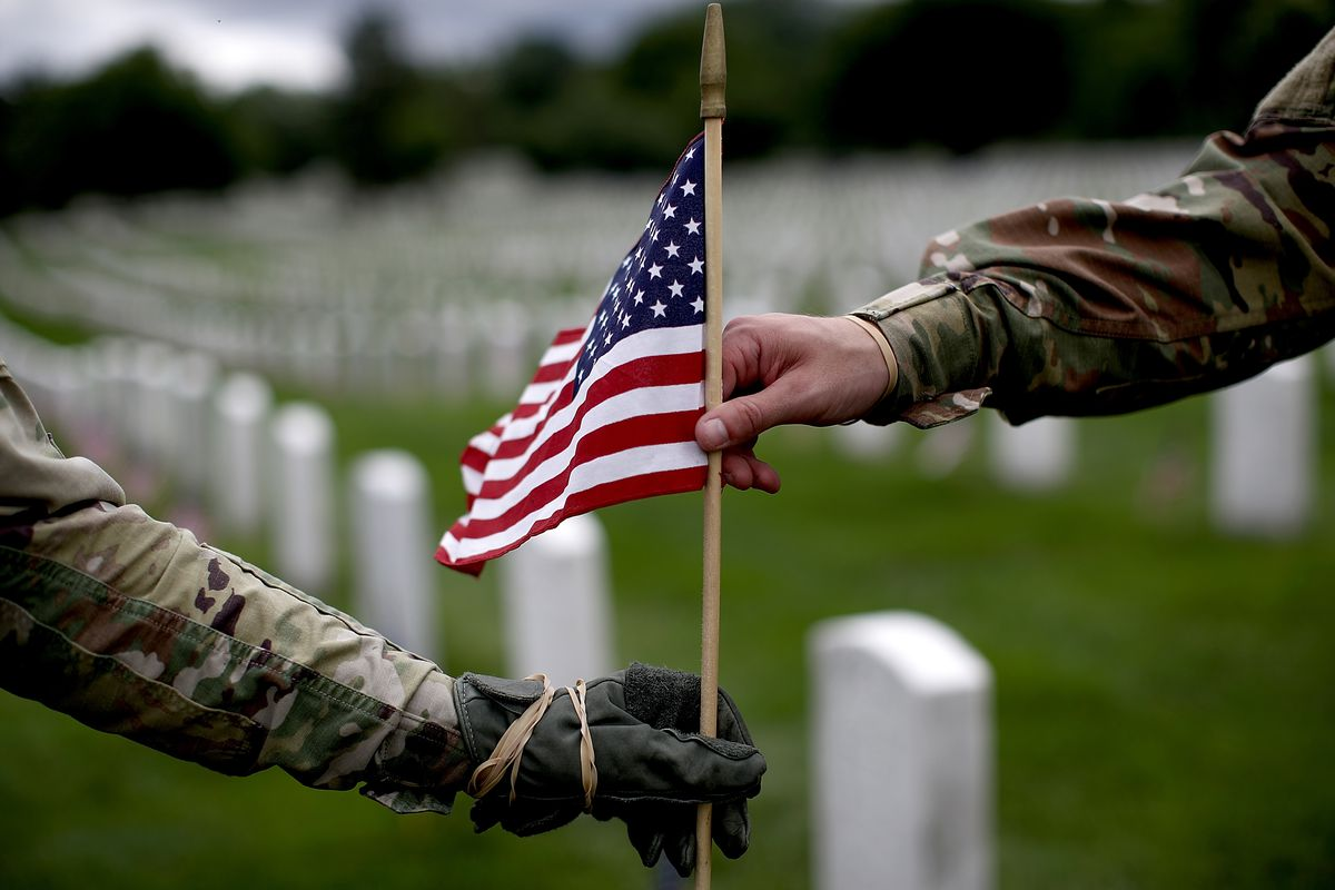 Fallen Soldiers Honored With 'Flags In' Tradition At Arlington Nat'l Cemetery