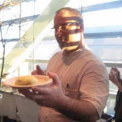Tarver King handing out pork buns.