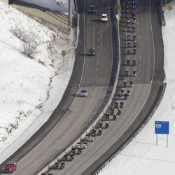 Firetrucks line an overpass as the funeral procession for Unified police officer Doug Barney makes its way to the Orem City Cemetery, where he will be laid to rest on Monday, Jan. 25, 2016. Barney was shot and killed in the line of duty by a man who seemingly had done nothing more than leave the scene of a traffic accident Sunday, Jan. 17, 2016.