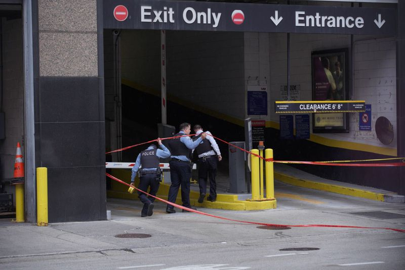 Chicago police investigate a shooting near Dearborn Street and Grand Avenue, May 15, 2021.