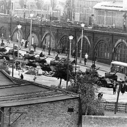 In this Aug. 13, 1961 b/w file picture East German tanks are lined up at Warschauer Bridge in Berlin, Germany. Crossing points between East and West Berlin were heavily guarded after Communists prevented East Germans from crossing into the West sector in an effort to stop heavy flow of refugees. AP Photographer Peter Hillebrecht was on assignment in Berlin as the construction of the Berlin Wall starts on Aug. 13, 1961 and he was one of the first photographers to  cover this historic event. When the wall was first built, nobody knew what was going to happen next. Many people were afraid that the wall would serve as a provocation and turn to the Cold War into a hot one.