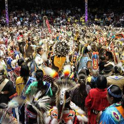 Hundreds of Native American and indigenous dancers pour onto the floor at University of New Mexico Arena for the grand entry during the 29th Annual Gathering of Nations in Albuquerque, N.M., on Friday, April 27, 2012. The three-day event draws more than 3,000 dancers and singers and tens of thousands of spectators.
