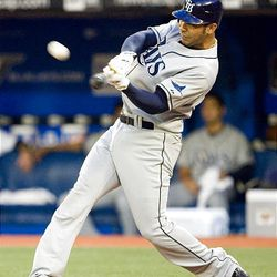 Tampa Bay Rays' Carlos Pena hits his second home run of the game off of Toronto Blue Jays pitcher Brett Cecil.