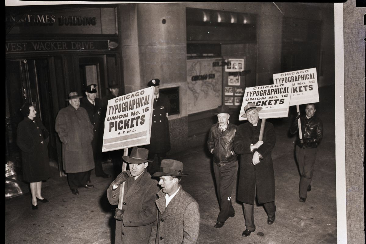 Members of the Chicago Typographical Union picket outside the Chicago Sun and Times building, circa 1947.