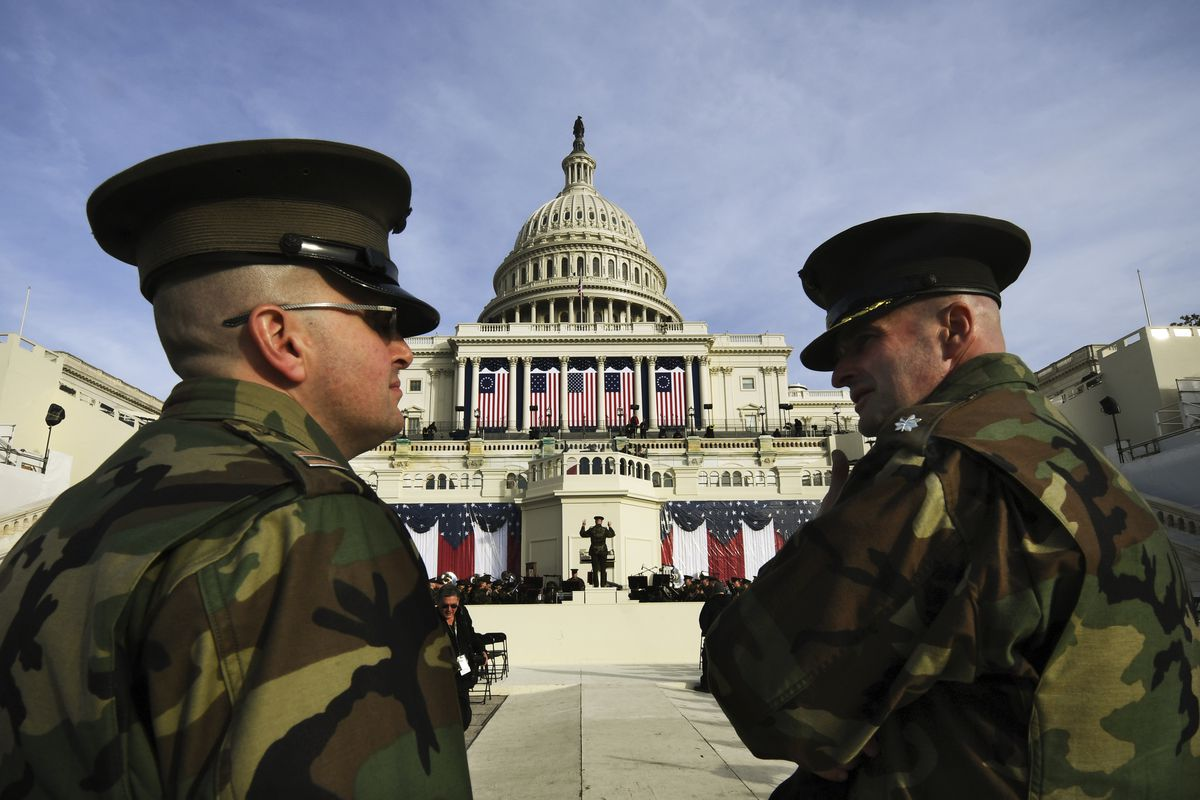 Members of the United States Marine Band rehearse in front of the Capitol Building for the inauguration of the 45th US president.