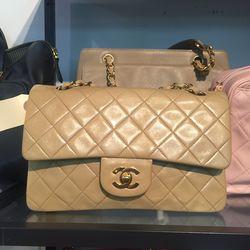 Chanel 2.55 lambskin bag in beige, $3,400