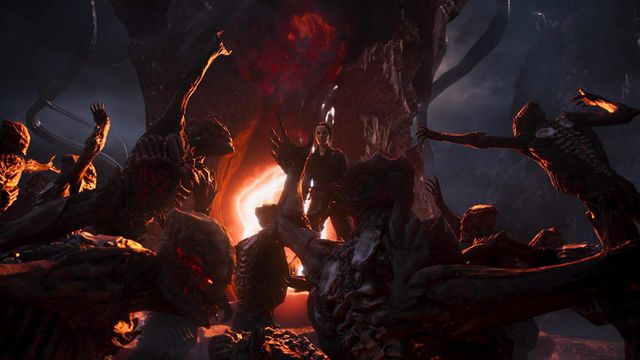 A doomed soldier stands in the middle of a group of demons