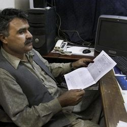 In this Thursday, Sept. 13, 2012 photo, Baluchistan Union of Journalists President Essa Tareen looks at the charge sheet that the Pakistani government has filed against the journalists in his office in Quetta, Pakistan. The telephone call to local journalists generally comes in the late evening. The voice on the other end is usually a Sunni militant with a statement he wants printed threatening of violence or claiming responsibility for attacks that already occurred. Journalists fear being killed if they don't print the messages.