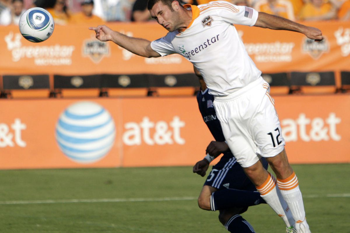 HOUSTON - APRIL 17:  Will  Bruin #12 of the Houston Dynamo has his header go wide of the goal in the first half against the New England Revolution at Robertson Stadium on April 17, 2011 in Houston, Texas.  (Photo by Bob Levey/Getty Images)