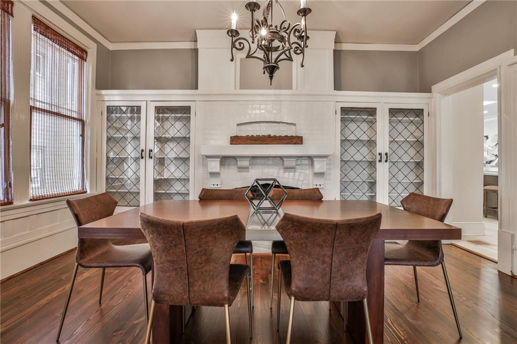 A large formal dining room with gray walls.