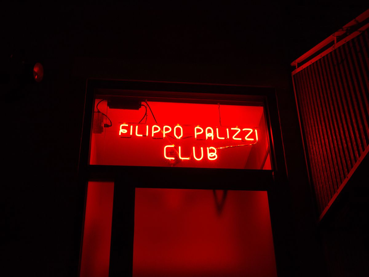 red neon sign that says filippo palizzi club