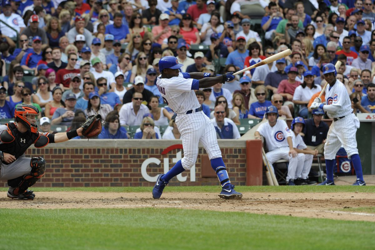 Alfonso Soriano of the Chicago Cubs hits a three-run homer against the San Francisco Giants at Wrigley Field in Chicago, Illinois. (Photo by David Banks/Getty Images)
