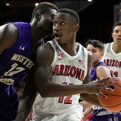 Arizona's Justin Coleman looks for an open teammate during the Arizona-Western New Mexico University game in McKale Center on October 30 2018 in Tucson, Ariz.