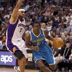 New Orleans Hornets forward Al-Farouq Aminu, right, drives to the basket past Phoenix Suns forward Jared Dudley, left, in the first quarter of an NBA basketball game Sunday, April 1, 2012, in Phoenix.