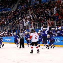 Gold medal winners the United States celebrate after defeating Canada in a shootout.