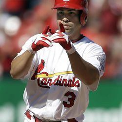 St. Louis Cardinals' Carlos Beltran points into the Cardinals dugout after hitting a two-run double during the sixth inning of a baseball game against the Houston Astros Thursday, Sept. 20, 2012, in St. Louis.