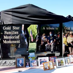 State and local leaders join with families as the Gold Star Families Memorial Monument is unveiled in North Ogden on Saturday, Aug. 1, 2020.