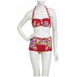 "<a href=""http://www.nanettelepore.com/swim/hula-gal-pin-up-skirt-16518.html""> Nanette Lepore Hula Gal halter top $84 and swim skirt, $96</a>, nanettelepore.com"