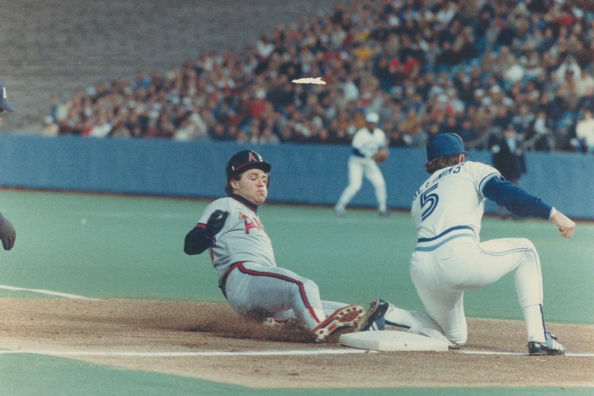 That kind of night: Dick Schofield of California Angels steals third base last night while Rance Mul