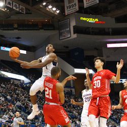 UConn's Christian Vital (1) puts up a layup but ended being called for a charge after bumping into BU's Cedric Hankerson (21).