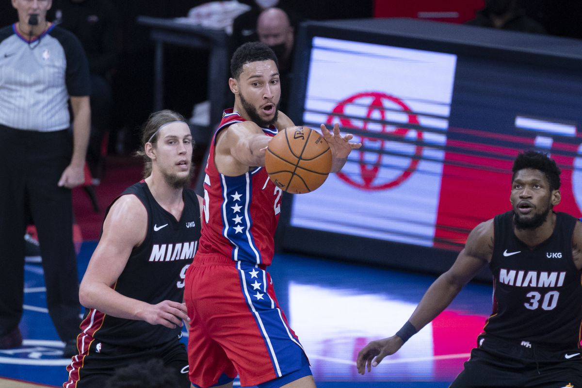 Philadelphia 76ers point guard Ben Simmons (25) passes the ball with Miami Heat power forward Kelly Olynyk (9) and Miami Heat power forward Chris Silva (30)defending during the second half at Wells Fargo Center.