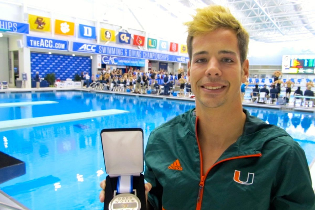 Tanner Wilfong poolside with his silver medal.