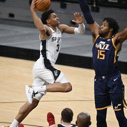 San Antonio Spurs' Keldon Johnson (3) shoots against Utah Jazz's Derrick Favors during the second half of an NBA basketball game, Sunday, Jan. 3, 2021, in San Antonio.