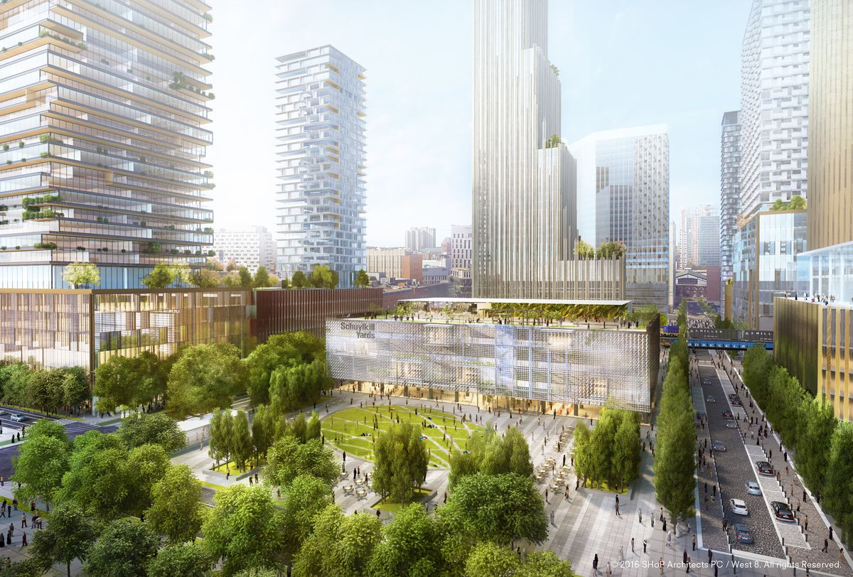 A rendering of Schuylkill Yards in Philadelphia. In the foreground is a park with trees and a lawn. In the distance are tall skyscrapers and buildings.