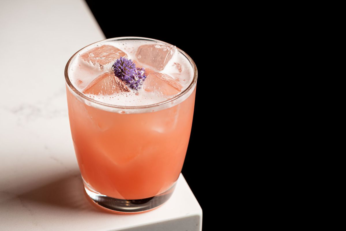 A light pink and fuzzy cocktail with jasmine inside.