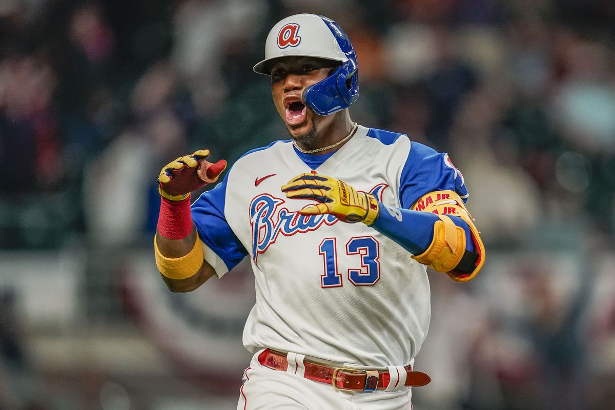 Atlanta Braves right fielder Ronald Acuna Jr. reacts after hitting a home run against the Miami Marlins during the seventh inning at Truist Park.