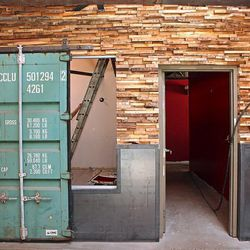 The walls of Ace are enforced with stacked pieces of pallet wood.