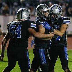 Stansbury players celebrate a touchdown during a high school football game against Tooeleat Stansbury High School in Stansbury Park on Friday, Sept. 17, 2021.