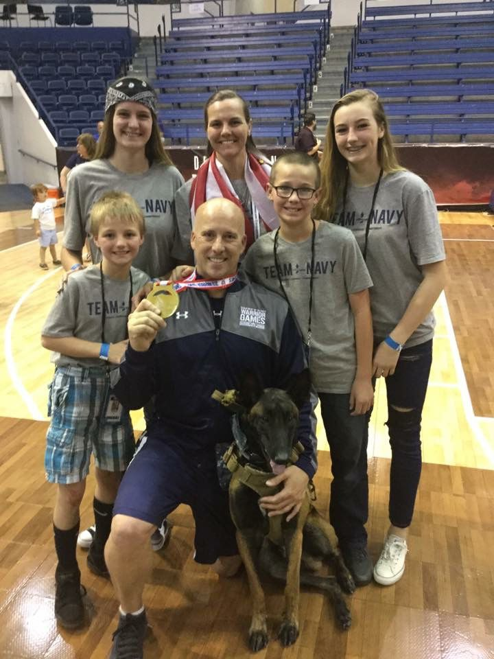 Carl Hill with his family and service dog at the Defense Department's 2018 Warrior Games for injured service members in Colorado Springs, Colorado. Hill later ran into trouble accessing his Post-9/11 GI Bill money for a daughter's college education.
