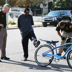 Utah Highway Patrol Col. Michael Rapich, left, and Lt. Jarod Garcia arrest a man during Operation Rio Grande in Salt Lake City on Monday, Aug. 14, 2017.