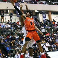 Young's Tyler Beard (0) floats down the lane for a layup against Morgan Park.