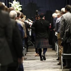 Andrew Morrill plays the bagpipes at the closing of a public memorial service for former Cougar football coach LaVell Edwards at the Provo Convention Center on Friday, Jan. 6, 2017.