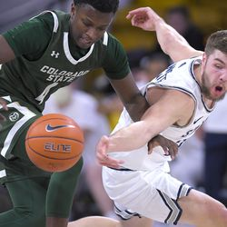 Utah State guard Rollie Worster, right, steals the ball from Colorado State guard Isaiah Stevens (4) during the first half of an NCAA college basketball game Thursday, Jan. 21, 2021, in Logan, Utah.