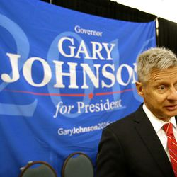In a Friday, May 27, 2016, file photo, Libertarian presidential candidate Gary Johnson speaks to supporters and delegates at the National Libertarian Party Convention in Orlando, Fla.