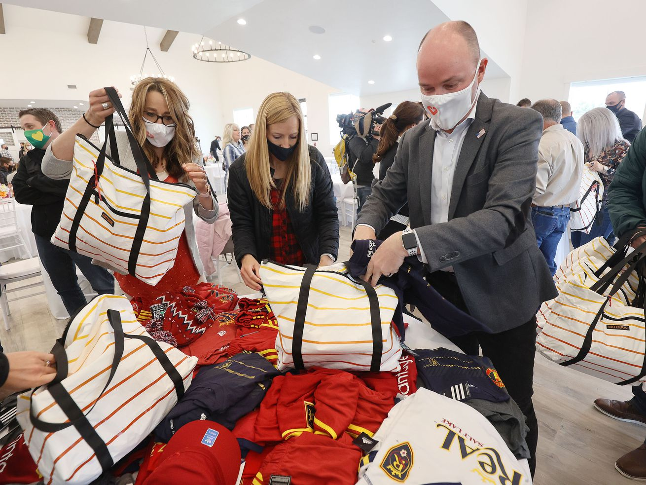 Utah first lady Abby Cox, left, her sister Lisle Dewey, center, and husband Gov. Spencer Cox help put together 1,500 thank-you kits for Utah's foster and kinship families at Bridle Up Hope in Alpine on Tuesday, April 27, 2021. During the service project, Abby Cox announced her new statewide initiative called Show Up Utah, a multifaceted endeavor aimed at promoting empathy in the state through service.