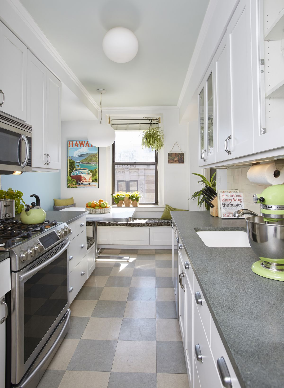 A kitchen with white cabinetry and checkered tiles.