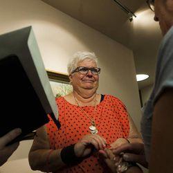 Leslie McWilliams, left, marries her partner of 18 years, Sheri Ault, at the Salt Lake County Clerk's Office in Salt Lake City, Monday, Oct. 6, 2014.